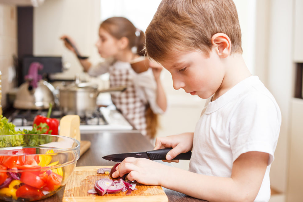 Child helping to prepare healthy food
